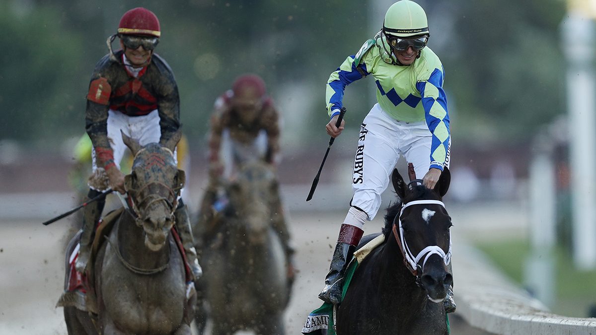 Jockey John Velazquez celebrates atop Always Dreaming #5 as they cross the finish line after winning the 143rd running of the Kentucky Derby at Churchill Downs on May 6, 2017, in Louisville, Kentucky.