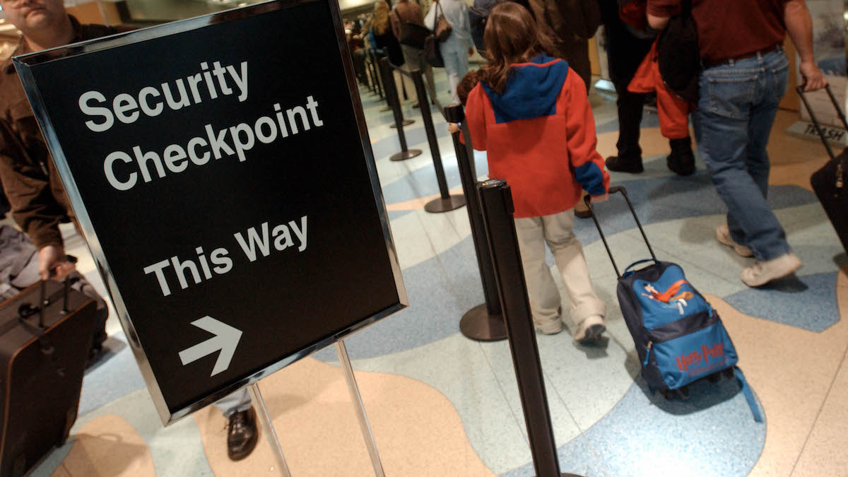 A file photo of a security check point sign at Logan Airport.