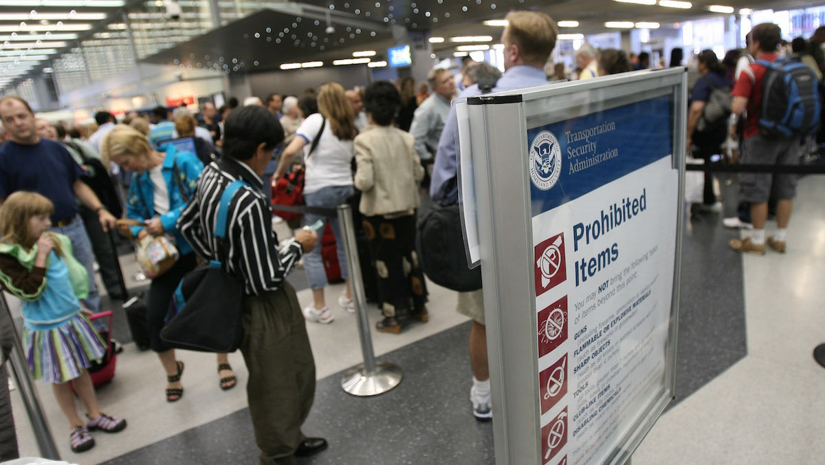 Travelers move through a TSA checkpoint at Chicago's O'Hare International Airport in this file photo.