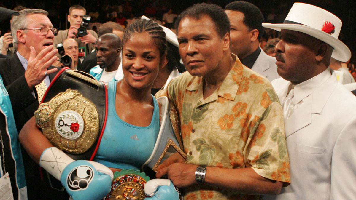 Laila Ali poses with her father, Muhammad Ali, after her 10 round WBC/WIBA Super Middleweight title bout with Erin Toughill at the MCI Center in Washington, DC. Ali won the fight via 3rd round TKO.