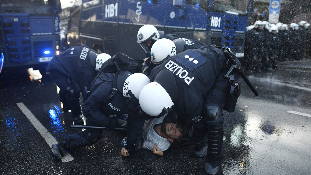 Police forces clash with protesters during a march on July 6, 2017, in Hamburg, Germany. Leaders of the G20 group of nations are arriving in Hamburg today for the July 7-8 economic summit and authorities are bracing for large-scale and disruptive protest efforts and heavy protests are expected tonight at the 'Welcome to Hell' anti-G20 protest.