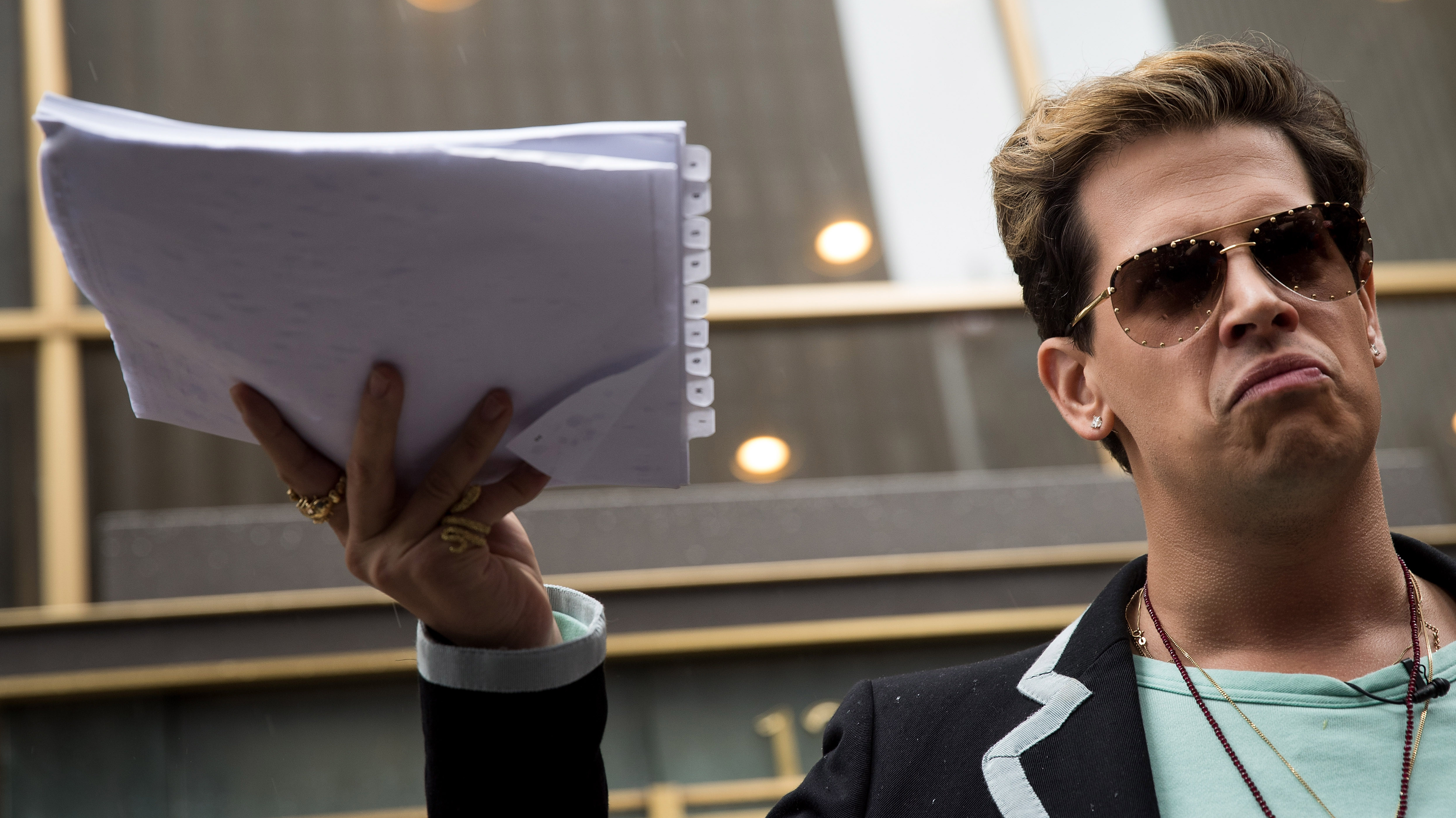 File image of Milo Yiannopoulos outside the offices of Simon & Schuster in New York City.