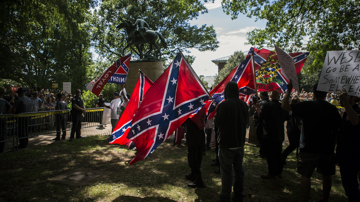 In this file photo Ku Klux Klan protests the planned removal of a statue of General Robert E. Lee on July 8, 2017, in Charlottesville, Virginia. Airbnb deleted accounts of people who planned lodging ahead of a similar, upcoming rally on Satuday, Aug. 12, 2017, that aims