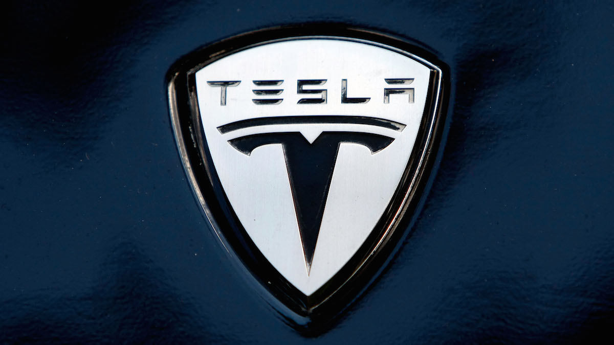 In this file photo, the Tesla electric car logo is shown during a display of alternative energy vehicles on Capitol Hill June 12, 2008 in Washington, DC.