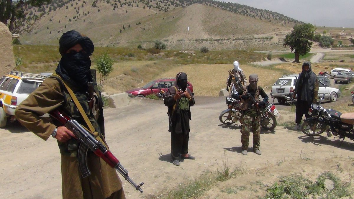 In this file photo, Fighters with Afghanistan's Taliban militia stand with their weapons in Ahmad Aba district on the outskirts of Gardez, the capital of Paktia province, on July 18, 2017.