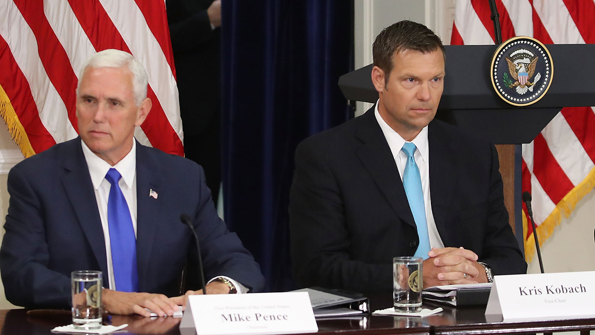 Kansas Secretary of State Kris Kobach and Vice President Mike Pence attend the first meeting of the Presidential Advisory Commission on Election Integrity in the Eisenhower Executive Office Building, on July 19, 2017, in Washington, D.C.
