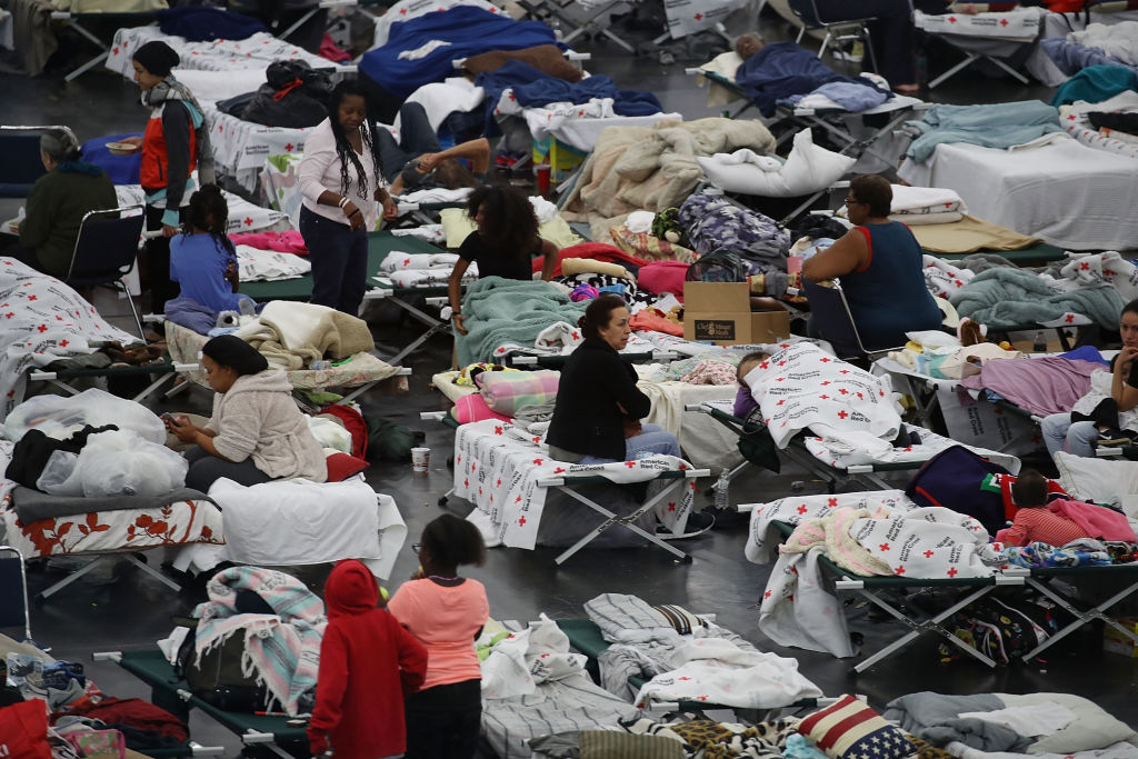 In this file photo, people take shelter at the George R. Brown Convention Center after flood waters from Hurricane Harvey inundated the city on Aug. 29, 2017, in Houston, Texas.