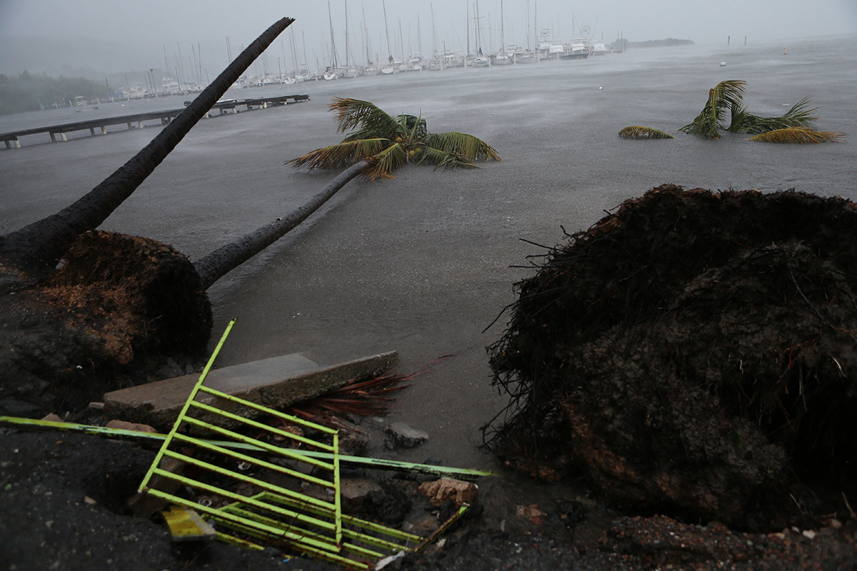 Debris is seen during a storm surge near the Puerto Chico Harbor during the passing of Hurricane Irma on Sept. 6, 2017, in Fajardo, Puerto Rico. The category 5 storm is expected to pass over Puerto Rico and the Virgin Islands today to make landfall in Florida by the weekend.