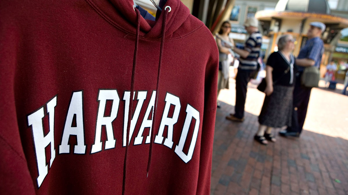 In this file photo, a Harvard University logo appears on a sweatshirt on display in Harvard Square in Cambridge, Massachusetts, U.S., on Friday, Sept. 4, 2009. The university has rescinded admissions offers to at least 10 prospective freshman after the students traded sexually explicit and other offensive graphics and messages in a private Facebook group chat.