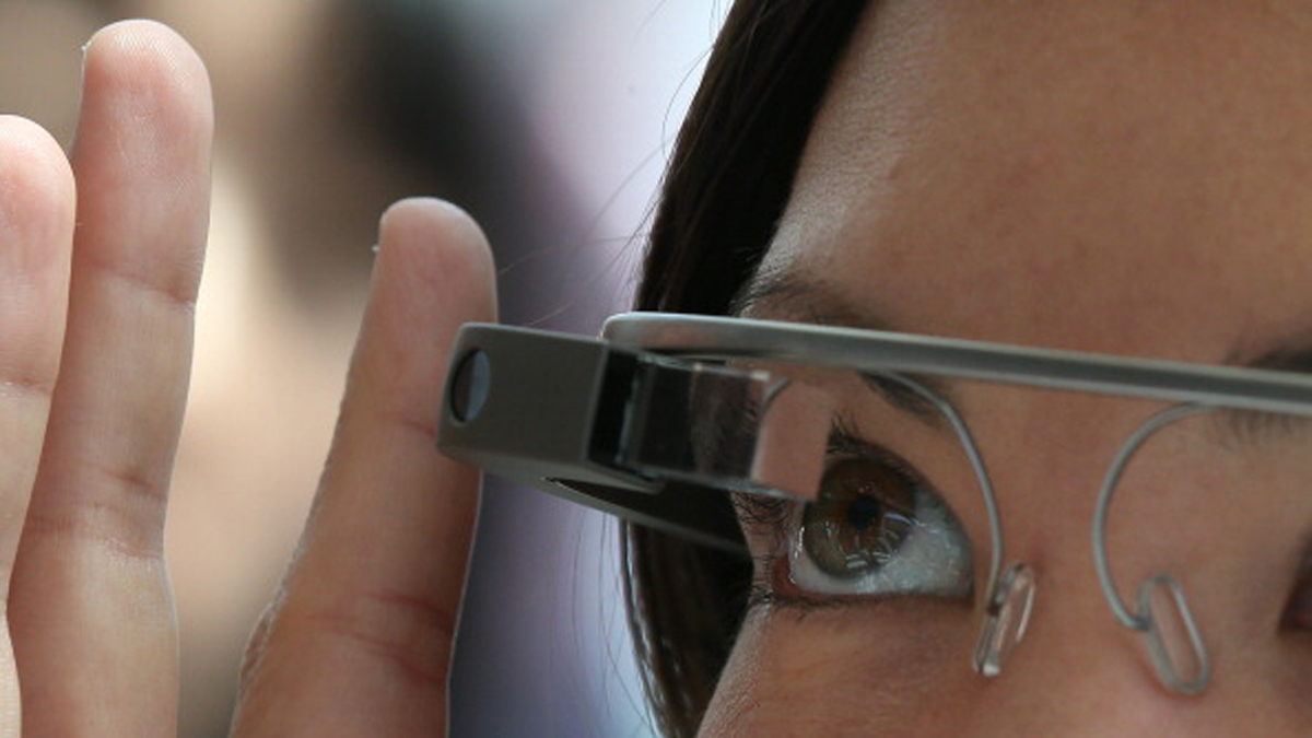A woman is seen wearing Google Glass in the file image. (Photo by Justin Sullivan/Getty Images)