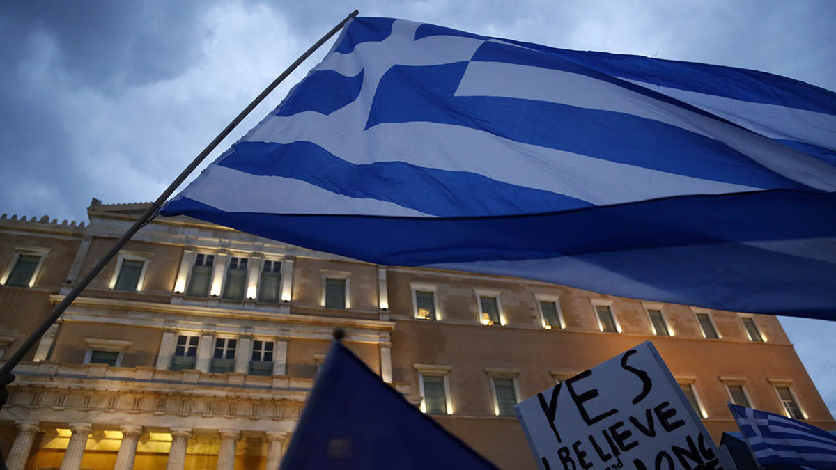 Demonstrators gather during a rally organized by supporters of the YES vote for a 'Grexit' referendum in front of the Greek Parliament in Athens, Tuesday, June 30, 2015.