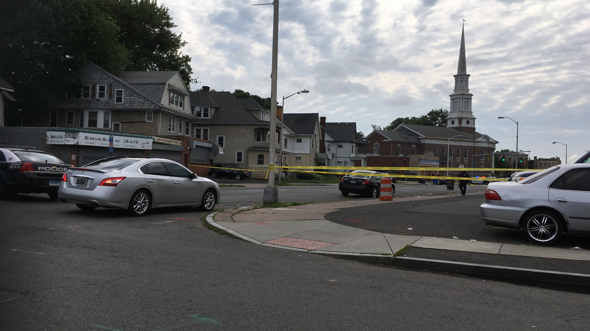 There is a large police presence on Albany Avenue near Vine Street in Hartford.