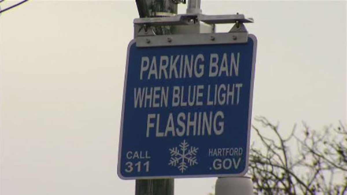 Blue lights will flash at key intersections to notify Hartford residents when there is a snow emergency parking ban.