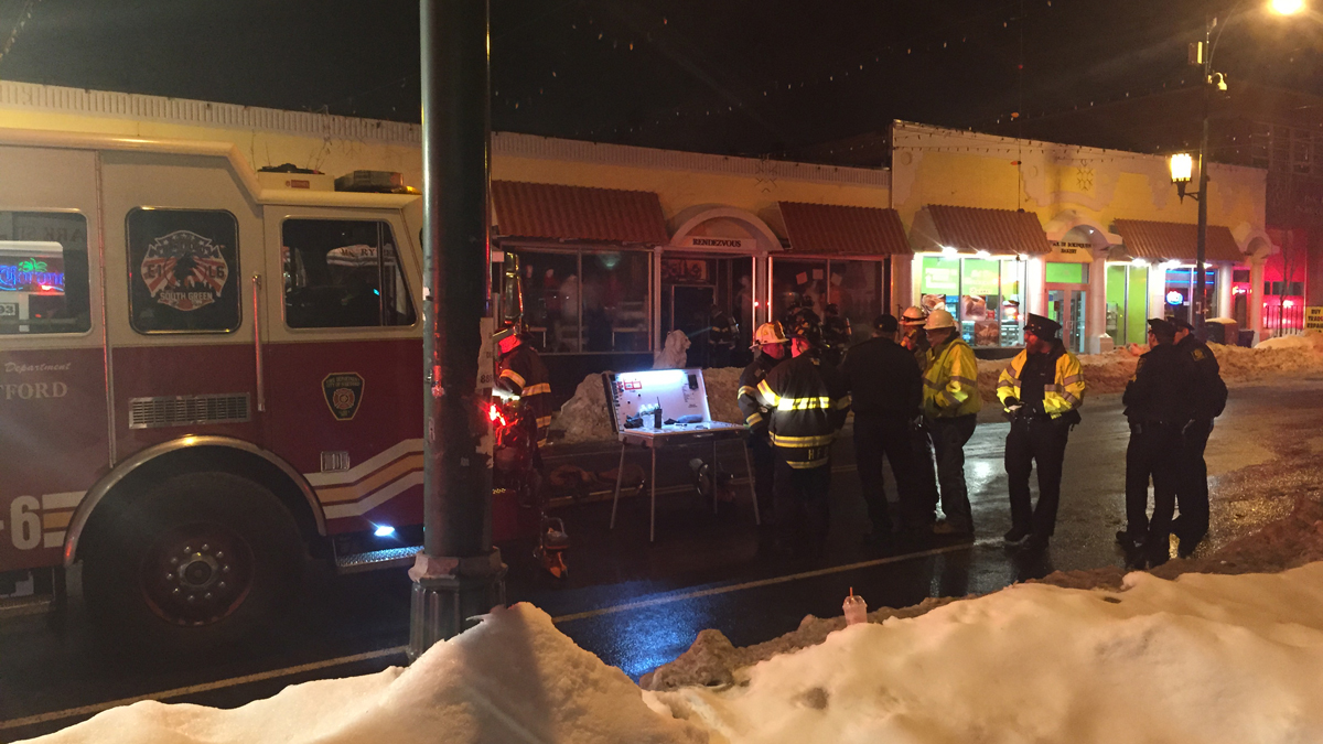 Firefighters on scene at 693 Park Street after a fire in a restaurant kitchen damaged several storefronts.
