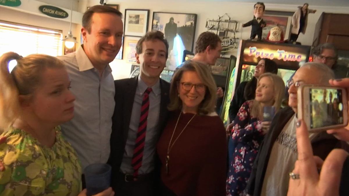Will Haskell (middle right) poses with U.S. Senator Chris Murphy.