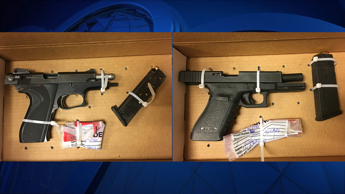 Hartford police recovered two guns during an encounter with armed suspects near a homicide vigil Tuesday night.