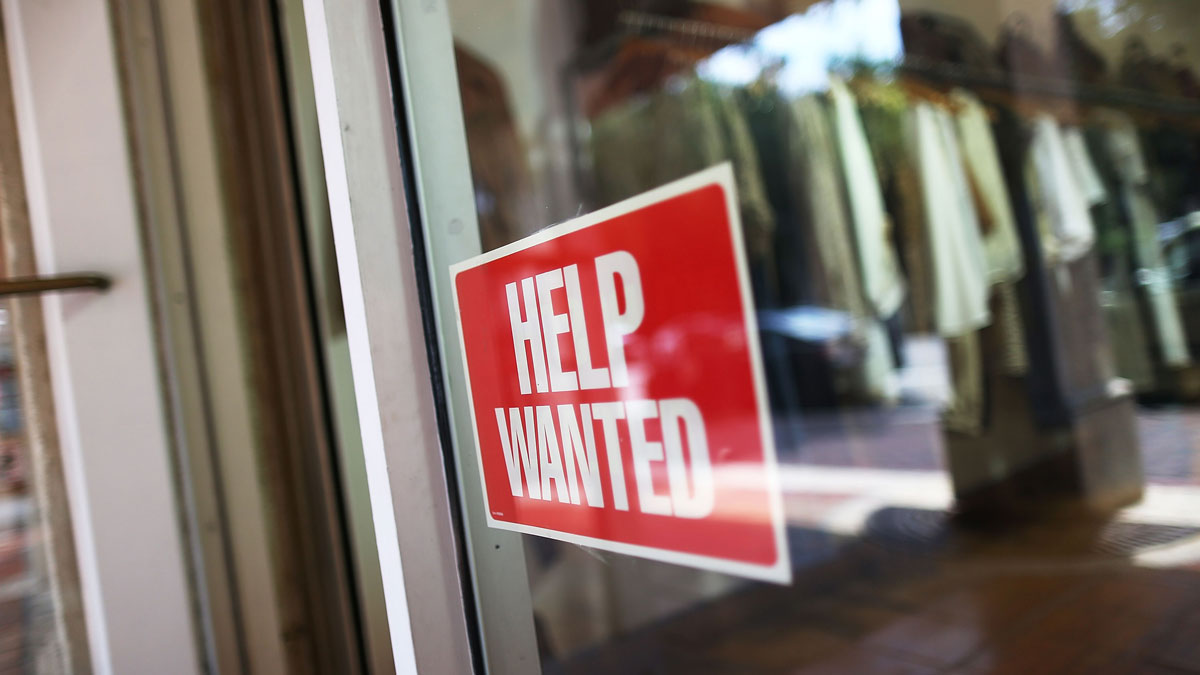 A help wanted sign is seen in the window of the Unika store on September 4, 2015 in Miami, Florida. The economy added 242,000 jobs in the month of February 2016.