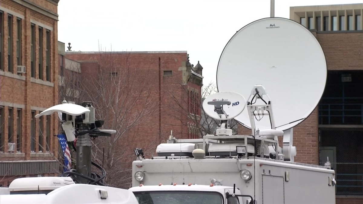 Satellite trucks swarmed Fall River, Massachusetts, on Friday as jury selection began in the murder trial of Aaron Hernandez.