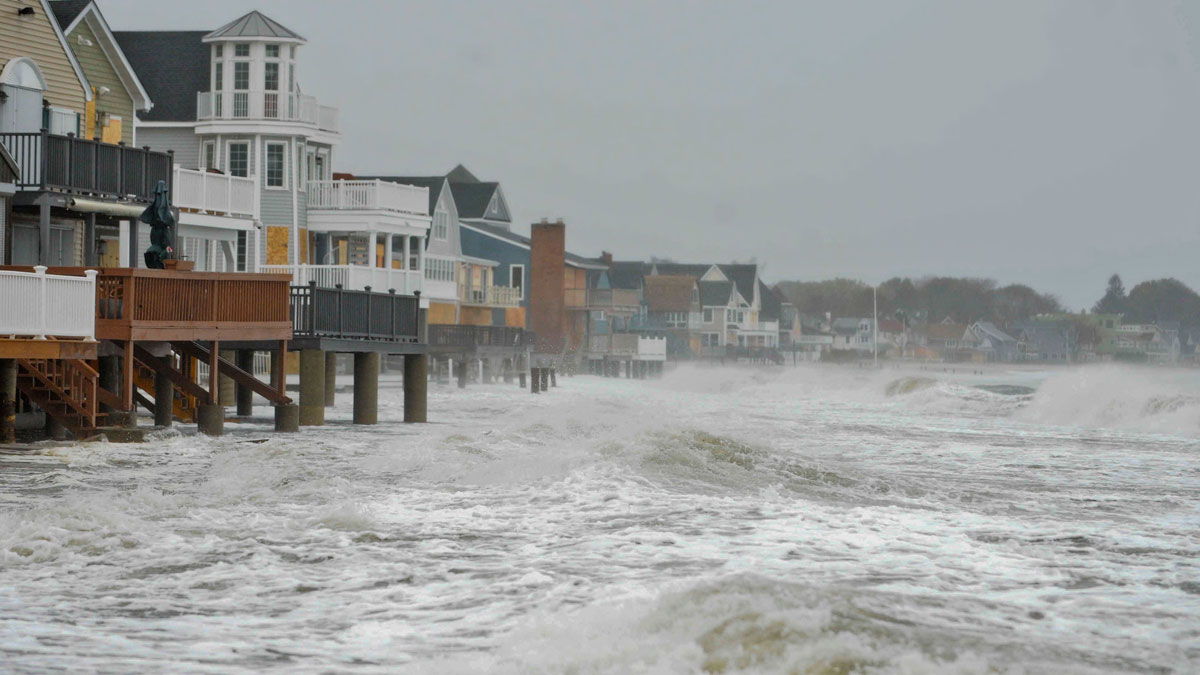 Ocean waves kick up along the shoreline in Milford, Conn., Monday, Oct. 29, 2012. Hurricane Sandy continued on its path Monday, as the storm forced the shutdown of mass transit, schools and financial markets, sending coastal residents fleeing, and threatening a dangerous mix of high winds and soaking rain.