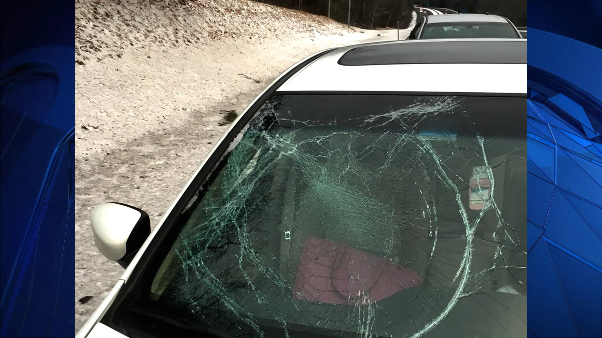 State police say ice flew off of a car driving on I-84 near Willington Wednesday and shattered the windshield of another vehicle traveling behind.