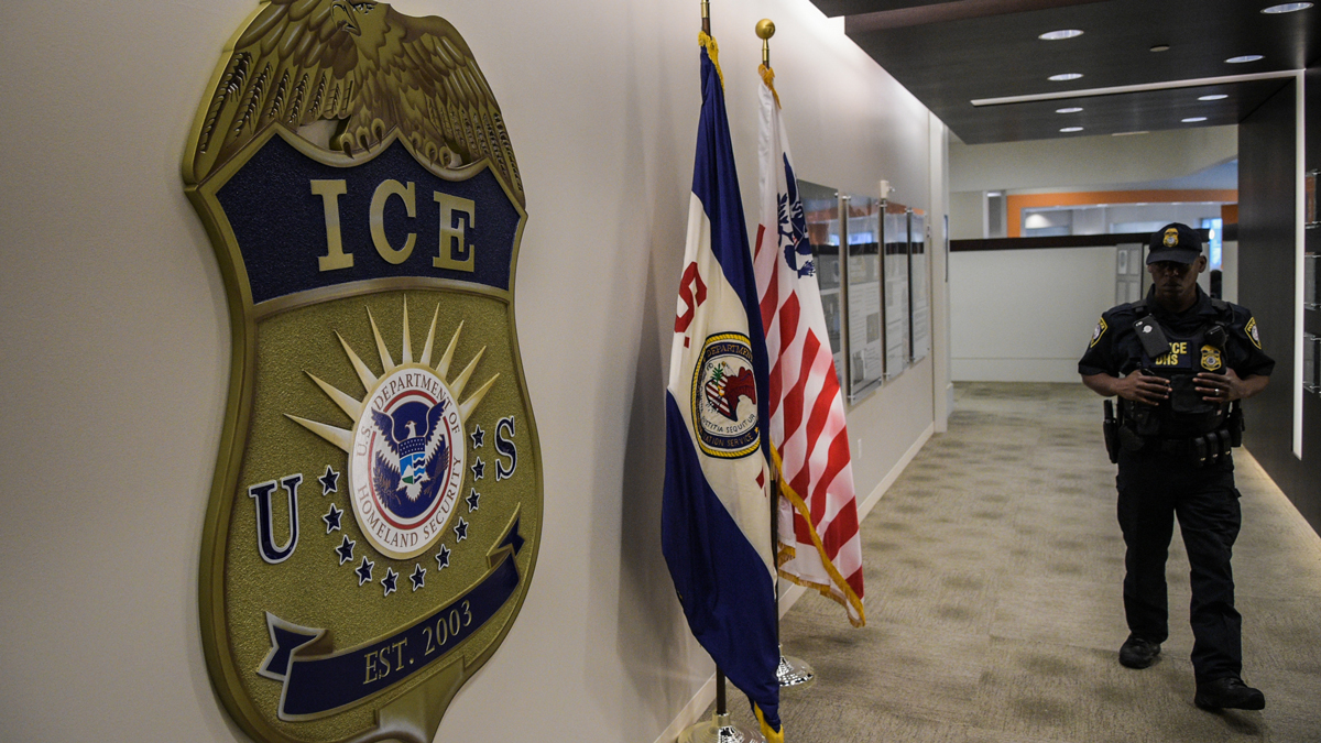 In this May 11, 2017, file photo, a law enforcement officer walks past the ICE logo ahead of a press conference at the U.S. Immigration and Customs Enforcement headquarters in Washington, DC.