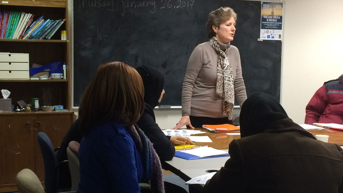Refugees attend an English class at IRIS in New Haven.