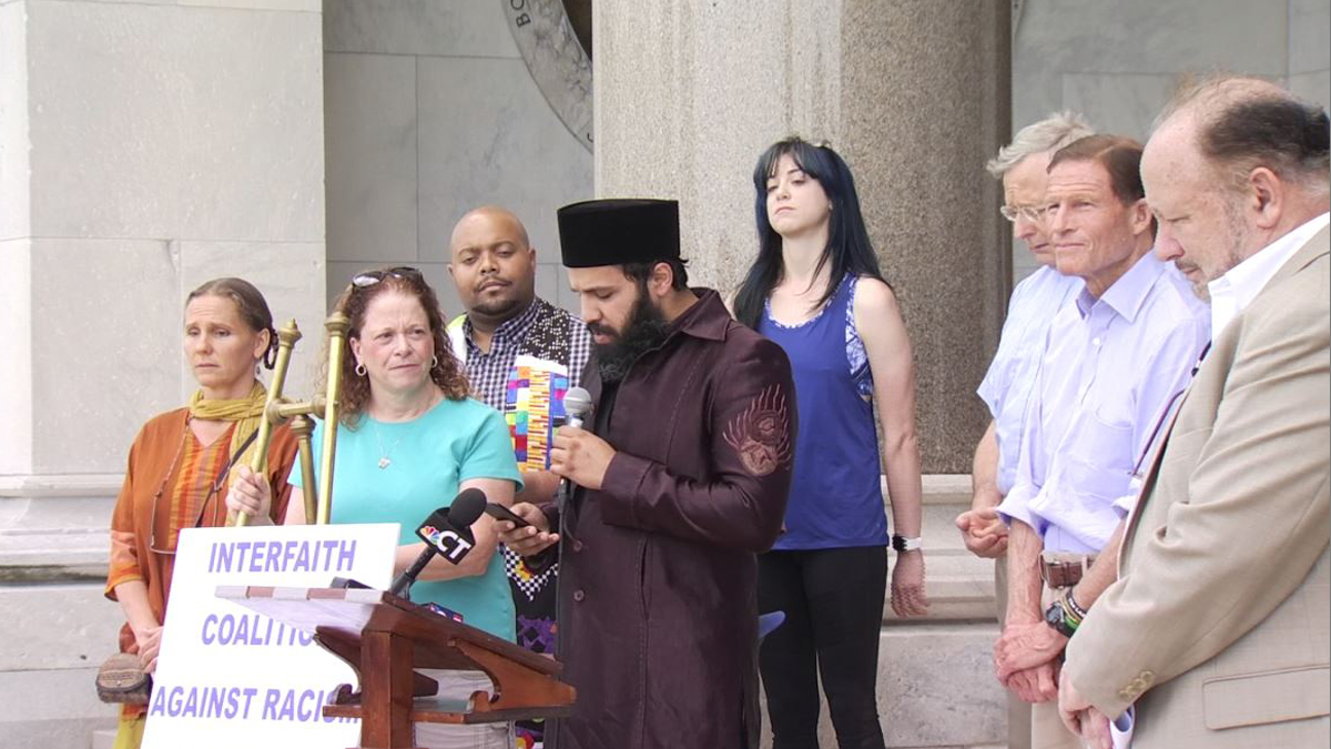 Dozens of people from various faiths rallied against hate outside the State Capitol in Hartford on Sunday.