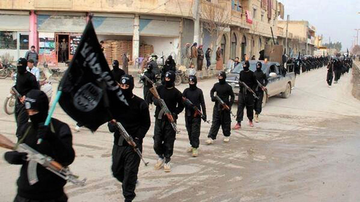 This undated file image posted on a militant website on Jan. 14, 2014, which has been verified and is consistent with other AP reporting, shows ISIS fighters marching in Raqqa, Syria. The ISIS documents obtained by NBC News indicate that two months after moving out of Ohio, Jaffrey Khan and his wife entered Syria at Tel Abyad, a city near the Turkish border that had just been captured by the so-called caliphate.