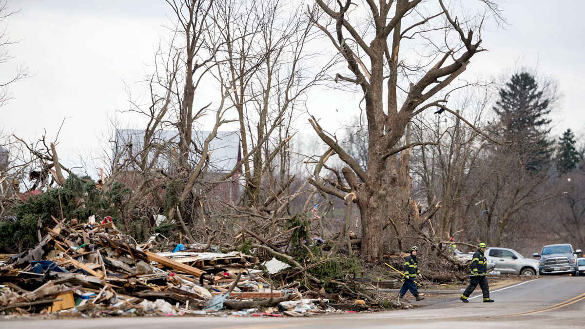 Crews search through the town for unaccounted people the morning after a tornado swept through the town on April 10, 2015 in Fairdale, Illinois. According to reports, 11 people were injured and one person was killed when tornadoes and thunderstorms passed through the northwestern suburbs of Chicago.