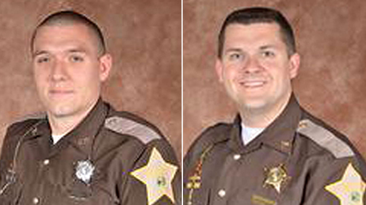 Deputy Carl A. Koontz (L), and Sergeant Jordan J. Buckley of the Howard County Sheriff Department. Koontz died and Buckley injured when they were shot while serving a warrant in Indiana.
