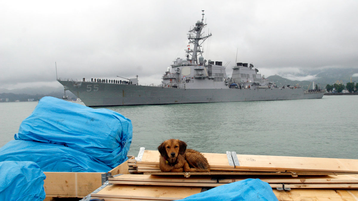 In this July 14, 2009, file photo, the U.S. guided missile destroyer USS Stout enters Georgia's Black Sea port of Batumi. A U.S. Navy ship fired three warning shots in the direction of an Iranian boat that was approaching another American ship head-on in the North Arabian Gulf on Wednesday, U.S. officials said, in an escalation of encounters in the region this week.