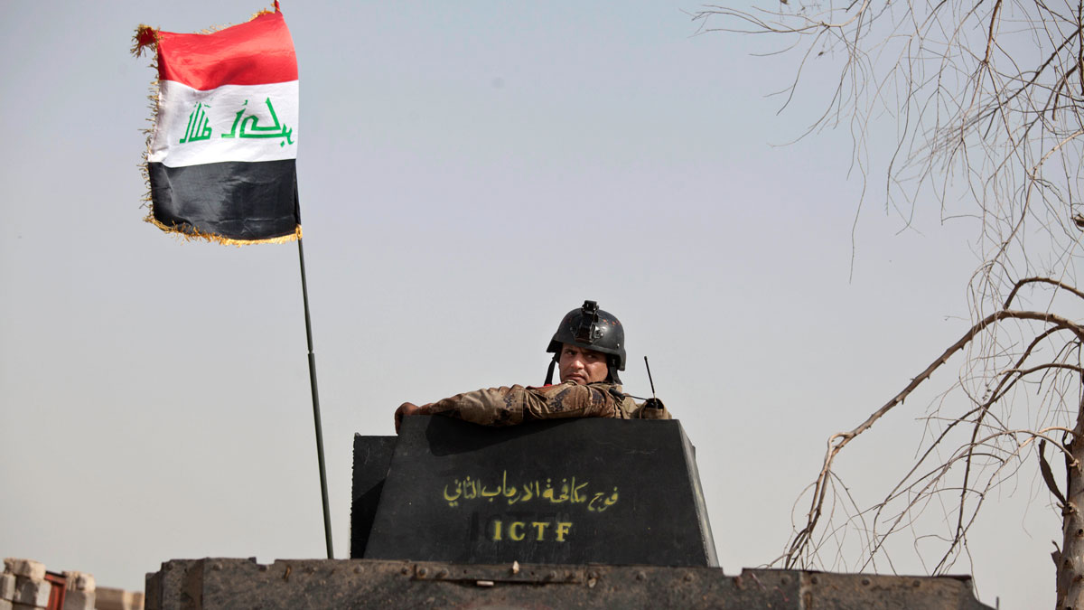 File photo: A soldier from Iraq's elite counterterrorism forces looks from the gun turret of a Humvee as troops gather on the edge of the Shuhada neighborhood in Islamic State-held Fallujah, Iraq, just before special forces pushed into the district on June 8, 2016.