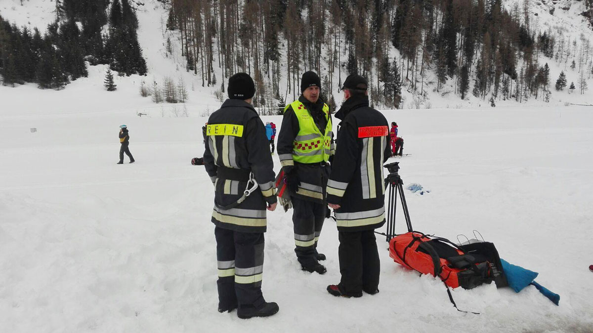 Rescuers prepare to board helicopters in Valle Aurina, in the Italian Alps, in order to reach the spot in Monte Nevoso where six backcountry skiers have died in an avalanche Saturday, March 12, 2016.
