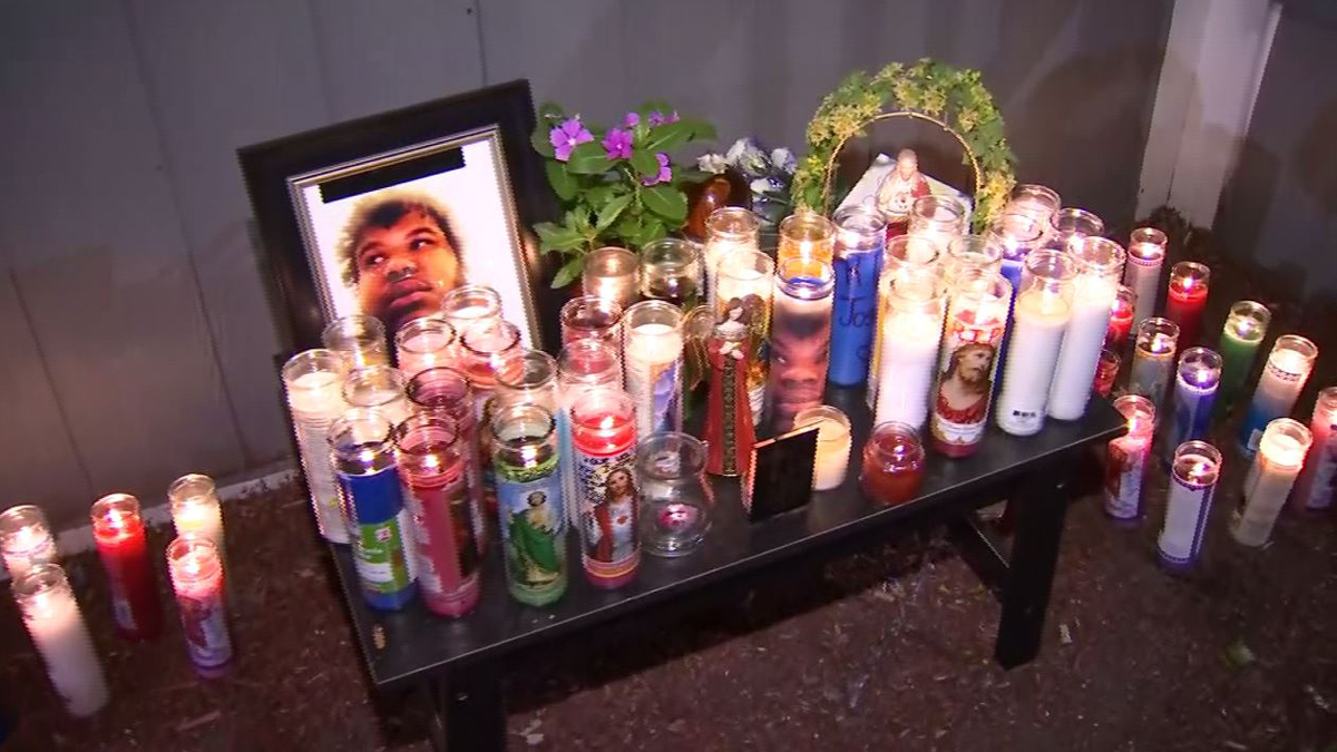 Friends and family held a vigil for Joshua Rivera, who was killed when a stray bullet went through a window and struck him in the head as he played video games.