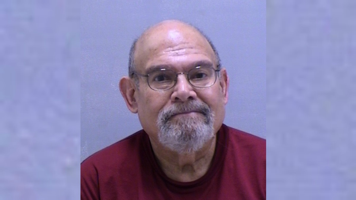 Police arrested Jan Marcus after complaints from a neighbor that he threatened to shoot her when she asked him to clean up after his dogs.