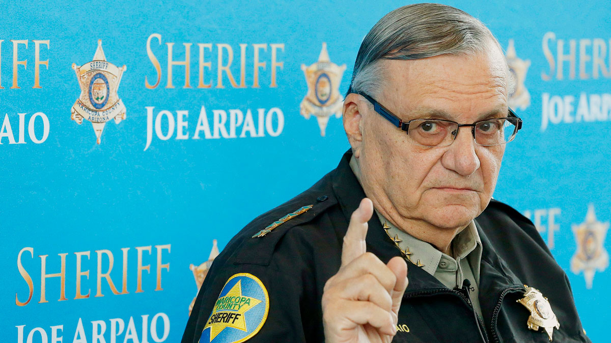 In this Dec. 18, 2013, file photo, Maricopa County Sheriff Joe Arpaio speaks at a news conference at the Sheriff's headquarters in Phoenix. A judge has found the longtime sheriff of metro Phoenix in contempt of court Friday for disobeying his orders in a racial profiling case, bringing the lawman who calls himself