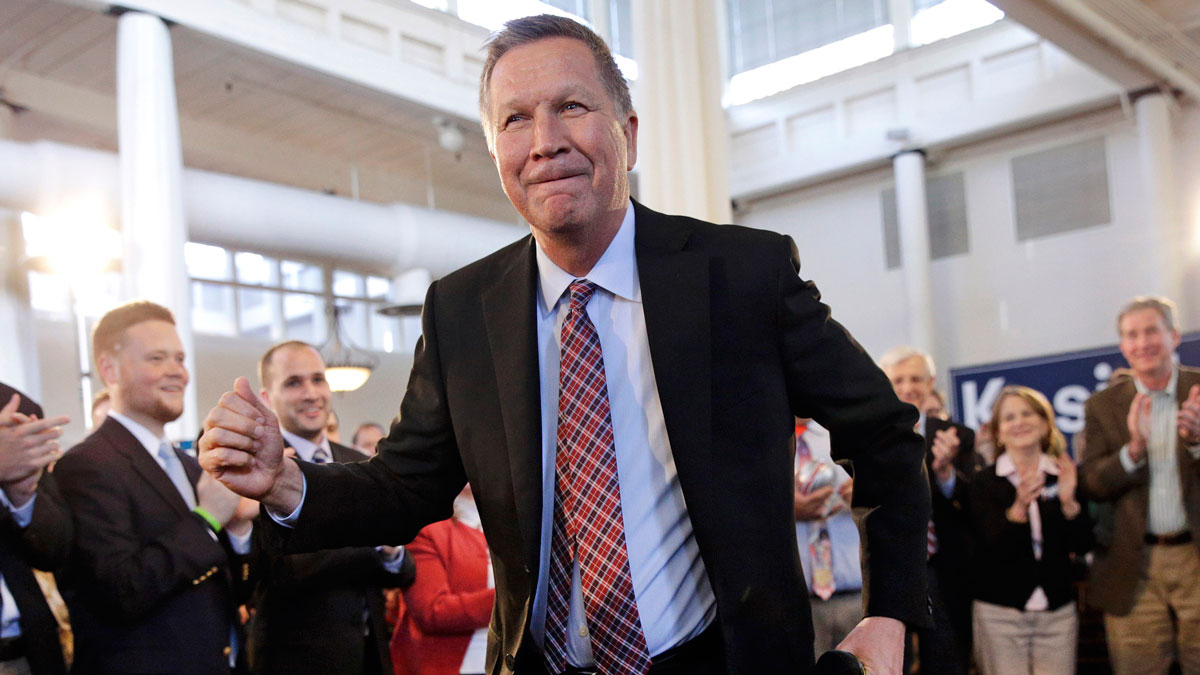 Republican presidential candidate, Ohio Gov. John Kasich dances after being introduced at a town hall at Savage Mill in Savage, Md., Wednesday, April 13, 2016.