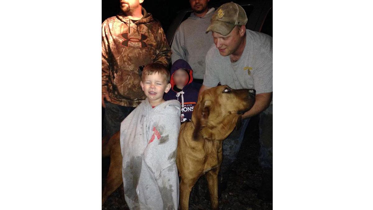 Doug Downs, his dog Honey, and 3-year-old Eli Alcock.