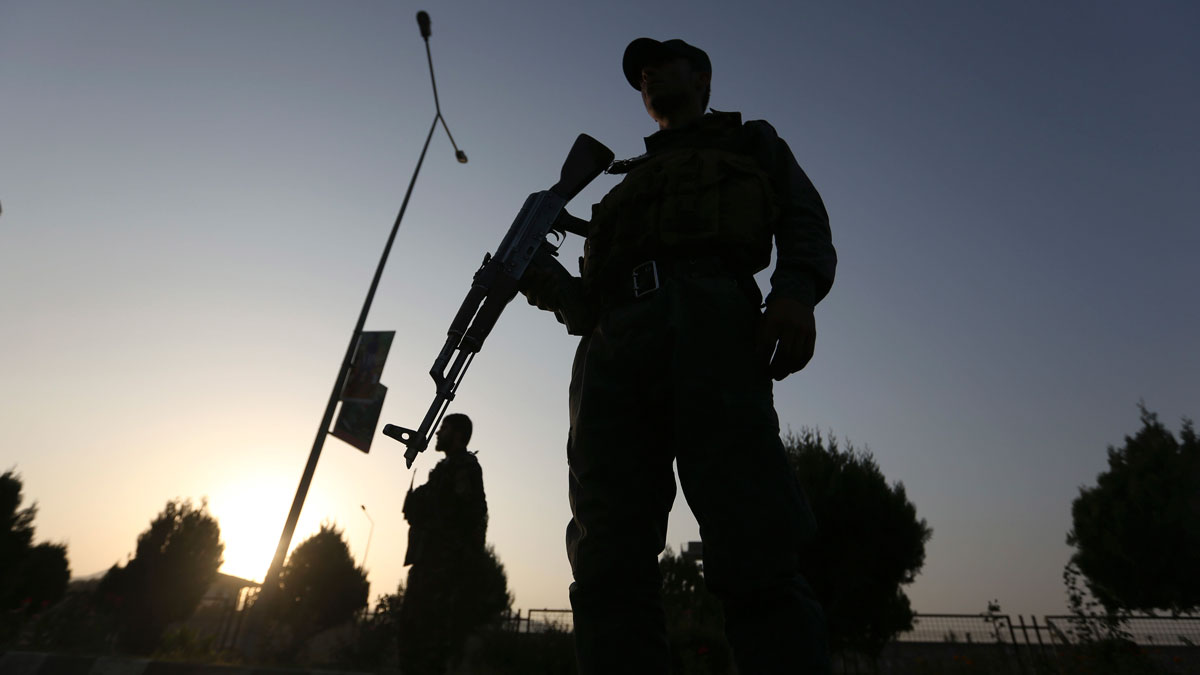 Afghan security forces stand guard after an attack on the American University of Afghanistan in Kabul, Afghanistan, on Aug. 25, 2016. The attack has ended, a senior police officer said Thursday, after several people were killed. Kabul police Chief Abdul Rahman Rahimi said the dead included one guard, and that about 700 students had been rescued.