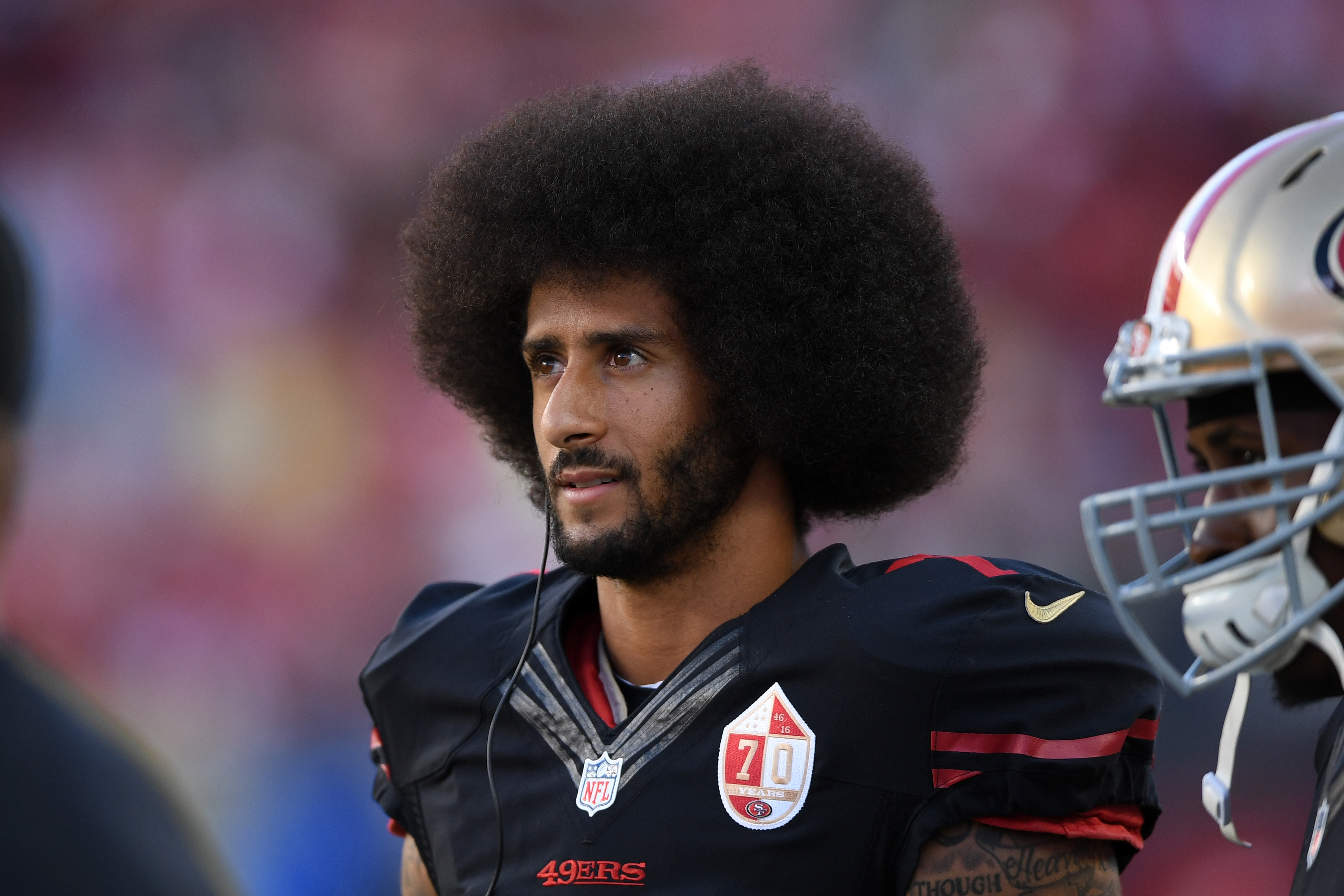Colin Kaepernick #7 of the San Francisco 49ers stands on the sidelines during their NFL game against the Arizona Cardinals at Levi's Stadium on October 6, 2016 in Santa Clara, California.