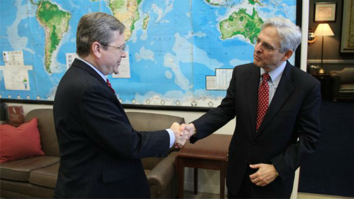 Sen. Mark Kirk tweeted a photo with Supreme Court nominee Merrick Garland Tuesday captioned with a message to fellow Republican lawmakers.
