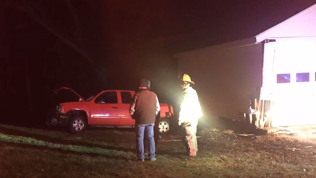 The Lebanon Volunteer Fire Department said a pickup struck a house and the garage of a home at the corner of Trumbull Highway and Burnham Road Tuesday.