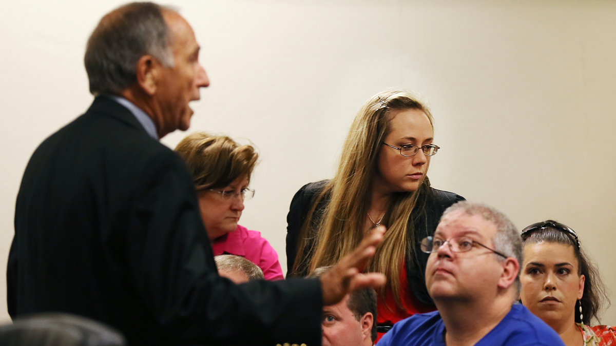 Leanna Harris, right, wife of Justin Ross Harris, the father of a toddler who died after police say he was left in a hot car for about seven hours, arrives for her husband's bond hearing in Cobb County Magistrate Court, Thursday, July 3, 2014, in Marietta, Ga