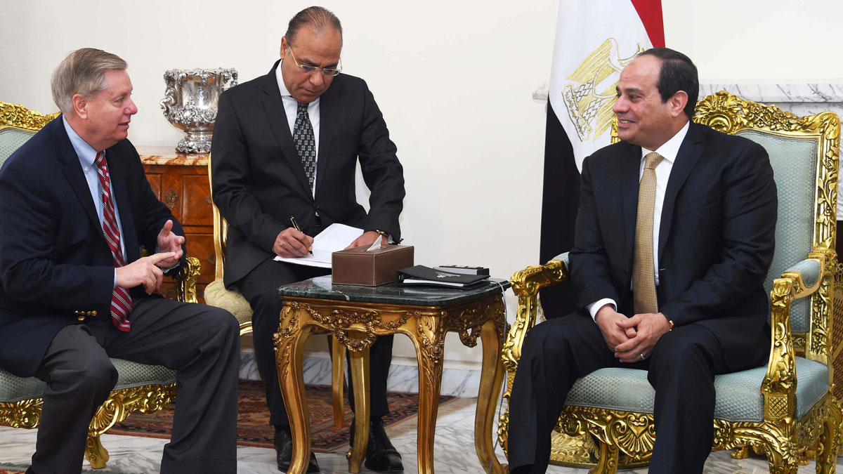 In this photo provided by Egypt's state news agency, MENA, Egyptian President Abdel-Fattah el-Sissi, right meets with Republican Sen. Lindsey Graham (left) at the office of the presidency in Cairo, Egypt.