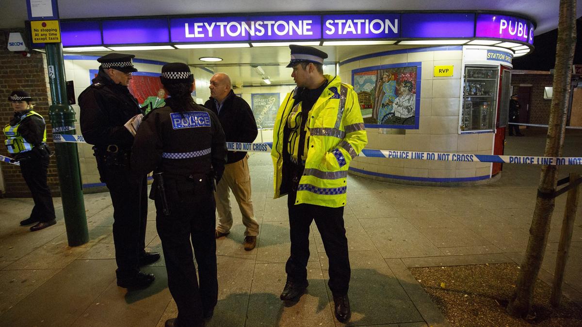 Police officers and crime scene investigators investigate a crime scene at Leytonstone tube station in east London, England, on December 05, 2015.