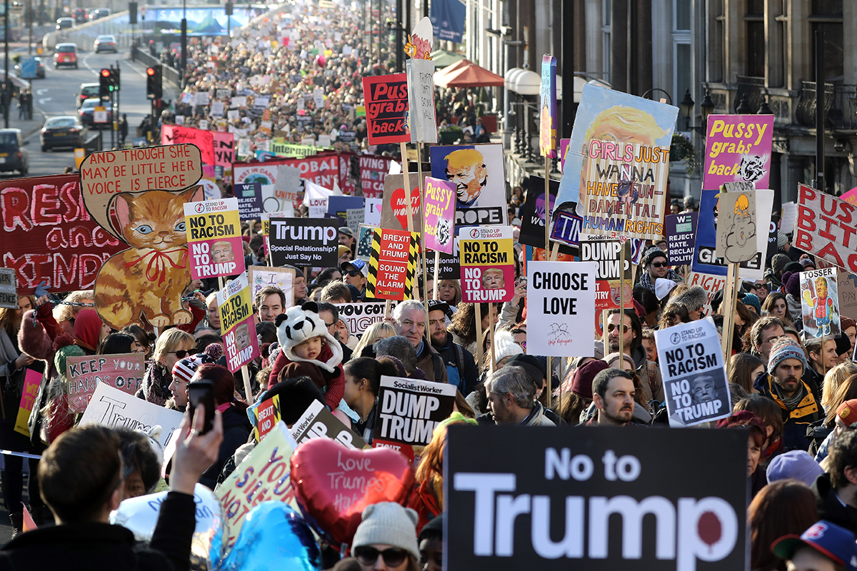 Protesters make their way through the streets of London during the Women's March on Jan. 21, 2017 in London, England.