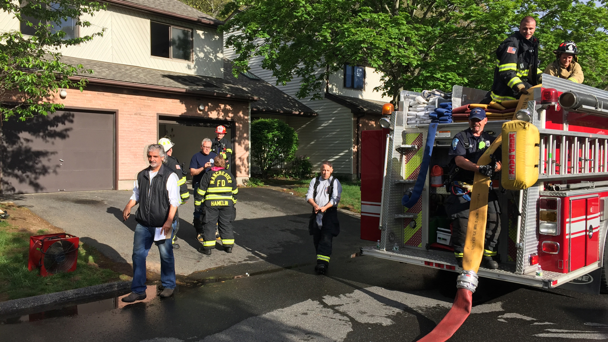 Firefighters battled a basement fire at a home on Oak Forest Road in Manchester Saturday