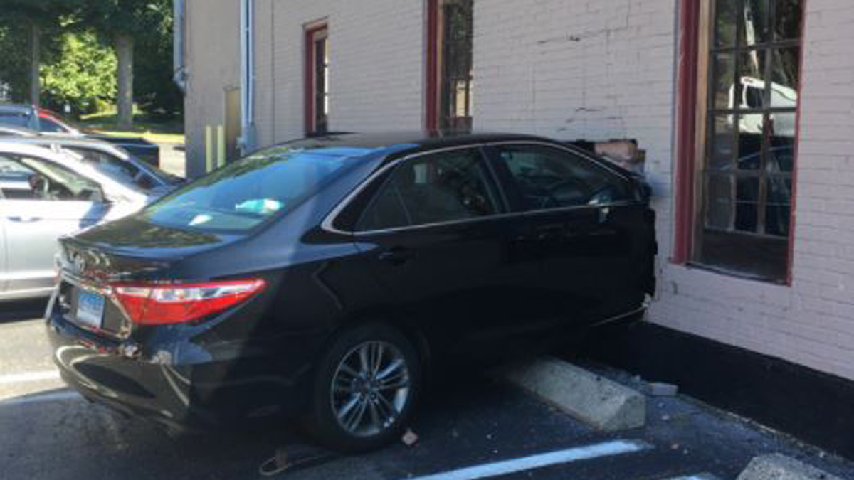 No one was hurt when a car crashed into the building at 940 Boston Post Road in Milford Wednesday.