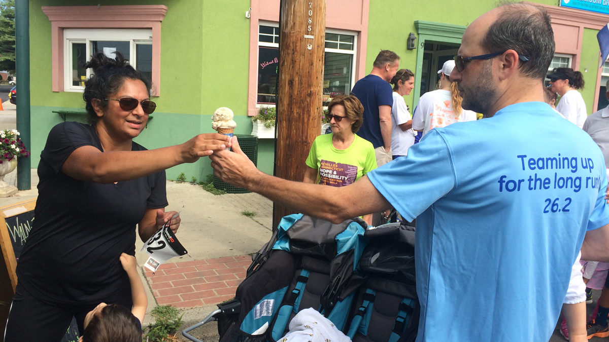 Runners share ice cream after completing the Walnut Beach Ice Cream Race, which benefits the Boys and Girls Club of Milford.