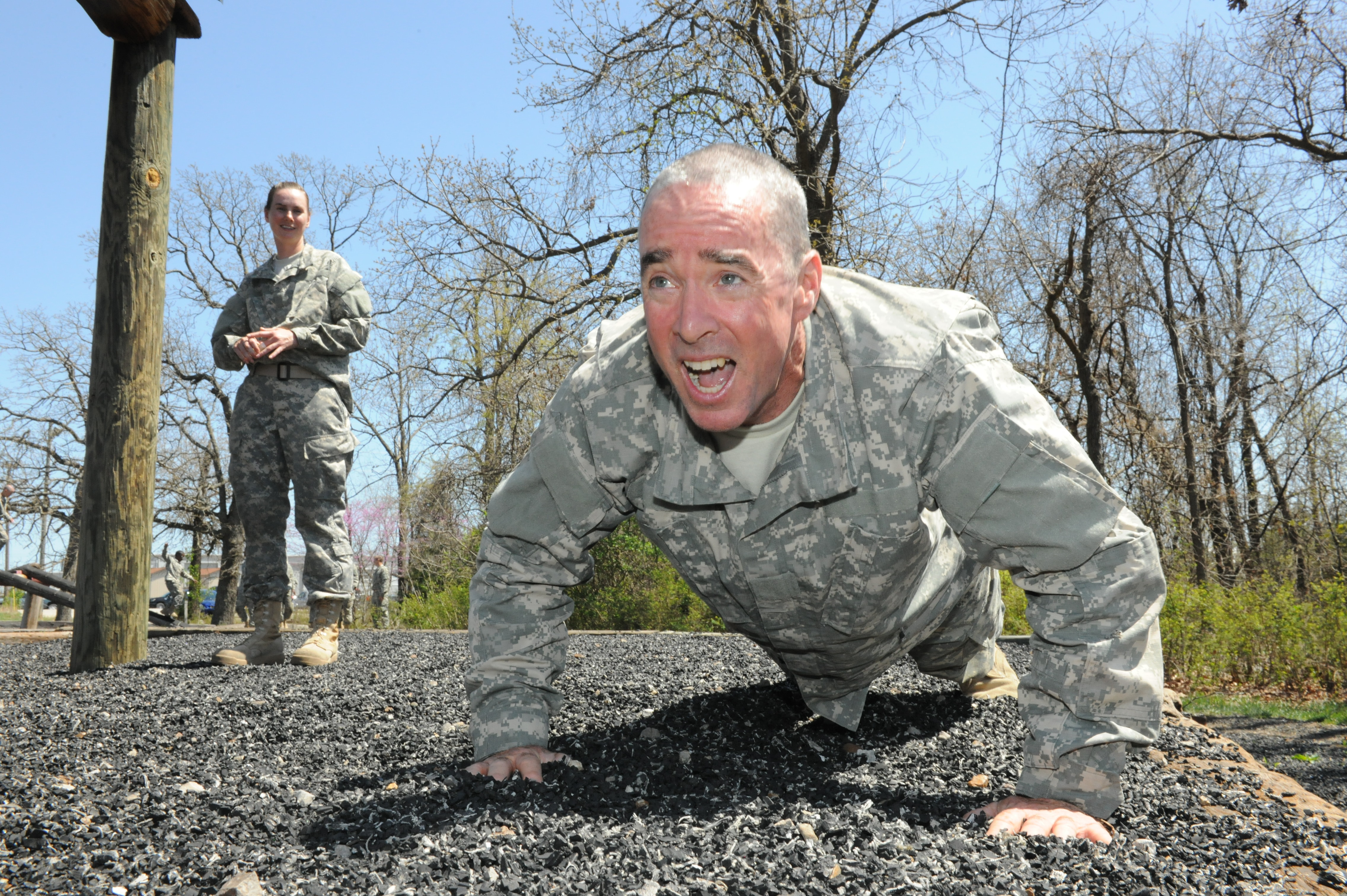 Sgt. 1st Class John Taffe of Alameda performs a crawl as part of an obstacle course at Fort Leonard Wood, Mo.